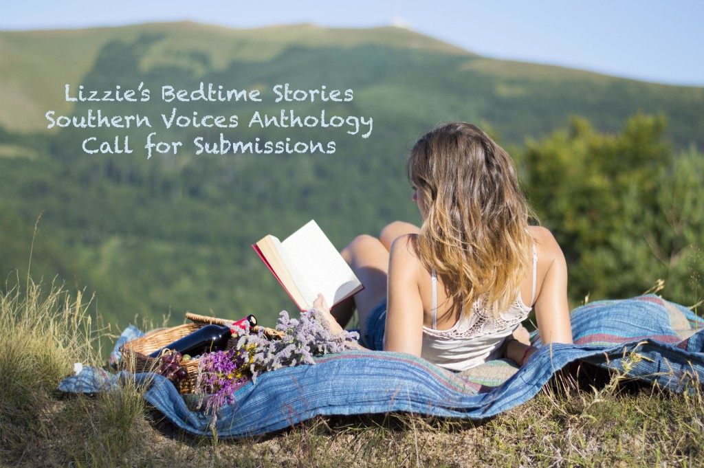 Girl laying on a blanket and reading a book on a picnic in the f